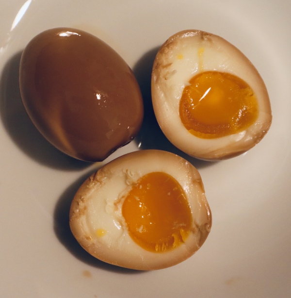 Photo of ramen egg whole & cut in half
